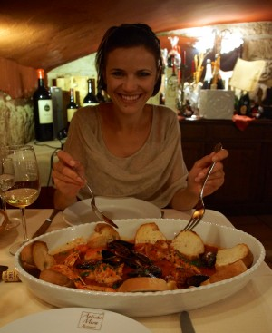 Sarah Digging in to Zuppa di Pesce